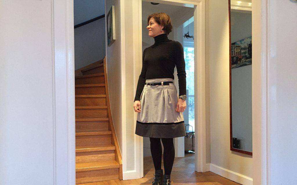 Variation On Black Turtleneck And Skirt